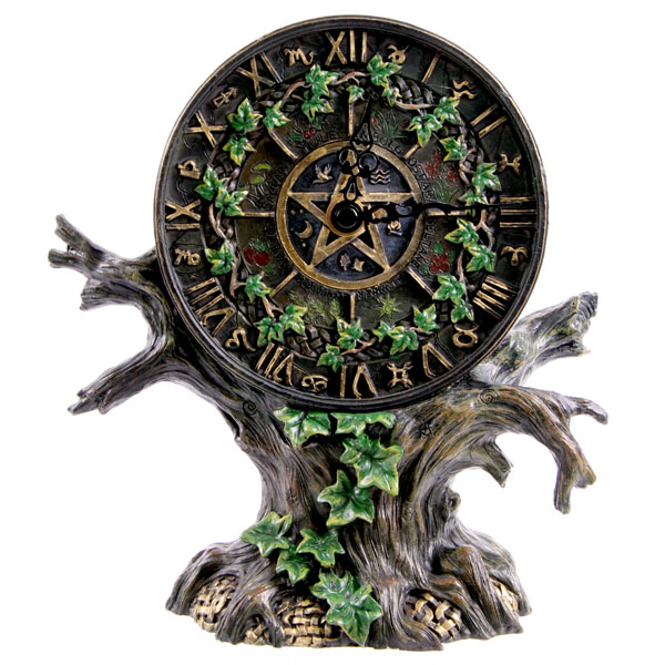 Reloj árbol pentagrama